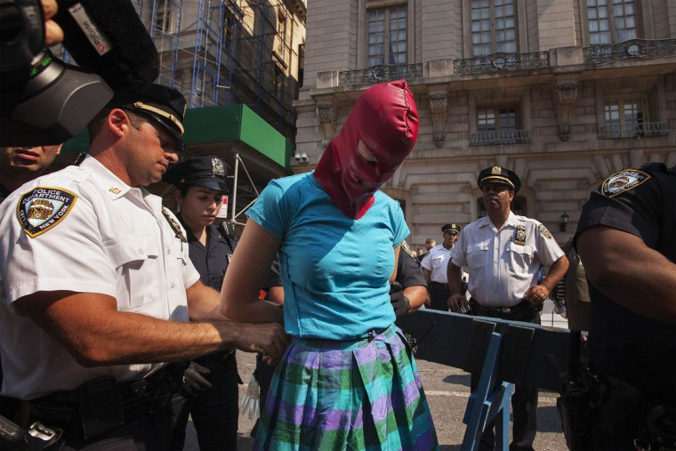 "NEW YORK CITY- AUGUST 17: New York Police Department officers arrest a woman demonstrating in solidarity with the Russian punk band Pussy Riot in front of the Russian Consulate in New York August 17, 2012. Three women from Russian punk band Pussy Riot were sentenced to two years in jail on Friday for their protest against President Vladimir Putin in a church, an outcome supporters described as the Kremlin leader's ""personal revenge"". (Lucas Jackson/Reuters)"