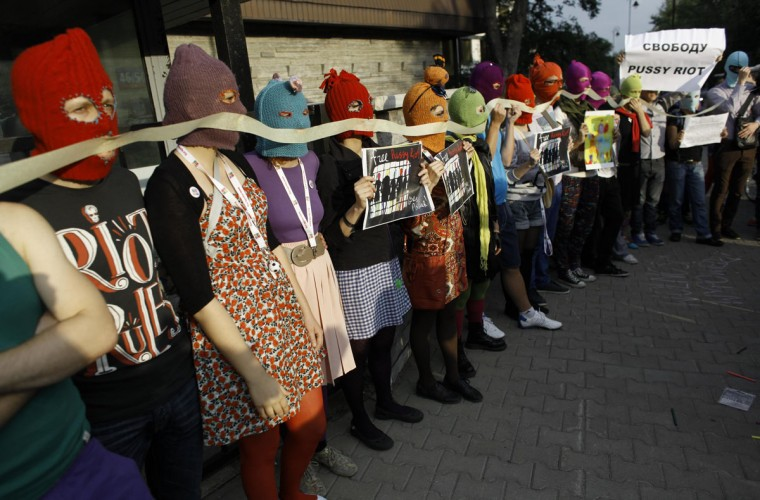 WARSAW, POLAND - AUGUST 17: Activists wear masks and hold posters in support of members of the female punk band Pussy Riot during a protest rally in front of the Russian Embassy, in Warsaw August 17, 2012. (Kacper Pempel/Reuters)