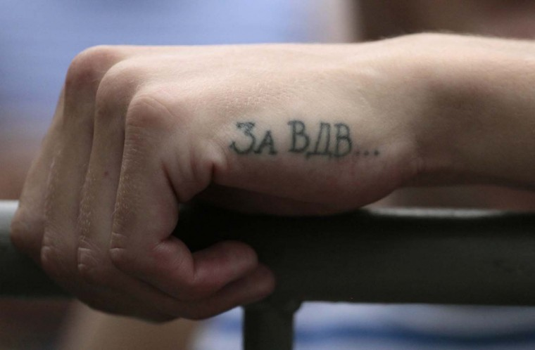 A tattoo is seen on a former Russian paratrooper's hand during the celebrations for Russian Paratroopers Day, an annual holiday, at the Central Park in the Siberian city of Krasnoyarsk, August 2, 2012. (Ilya Naymushin/Reuters)