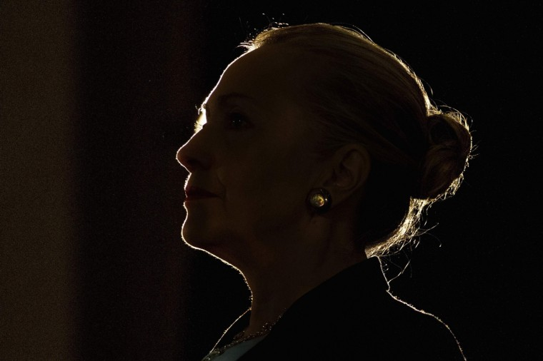 U.S. Secretary of State Hillary Clinton is silhouetted by a stage light as she speaks at the University of the Western Cape about the U.S.-South Africa partnership, in Cape Town. South Africa's next generation of leaders should honor the legacy of anti-apartheid hero Nelson Mandela by promoting democratic values around the world, Clinton said on Wednesday. (Jacquelyn Martin/Reuters)