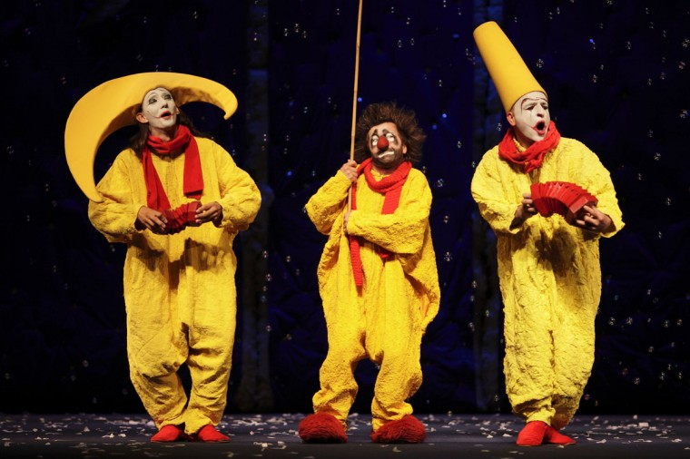 "Clowns perform during a scene from the media preview of the stage spectacle ""Slava's Snowshow"" at the Sands Theatre at the Marina Bay Sands in Singapore. The show will premiere this evening and continues until September 9. (Tim Chong/Reuters)"
