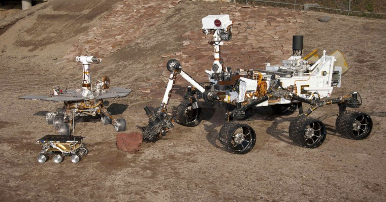 Three Generations of Rovers are pictured in the Mars Test Yard at NASA's Jet Propulsion Laboratory, Pasadena, California in this undated handout photograph. Front and left is the flight spare for the first Mars rover, Sojourner, which landed on Mars in 1997 as part of the Mars Pathfinder Project. The Mars Exploration Rover Project test rover (L) is a working sibling to Spirit and Opportunity, which landed on Mars in 2004. Next (R) is a Mars Science Laboratory test rover the size of that project's Mars rover, Curiosity, which is on course for landing on Mars on August 5, 2012. (NASA/JPL-Caltech/Handout/Reuters)