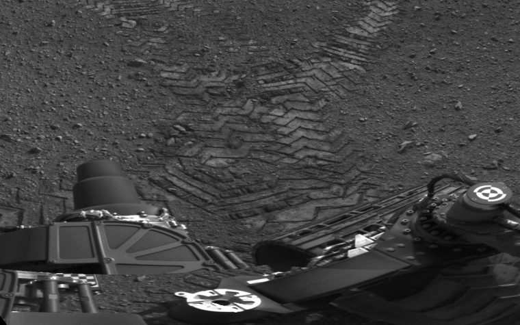 Handout image courtesy of NASA shows tracks left by the Curiosity rover on Mars August 22, 2012. (NASA/JPL via Reuters)