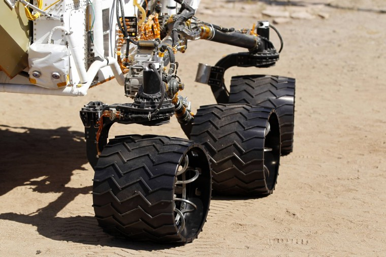 July 25, 2012: Three of six 20 inch aluminum wheels are seen on an engineering model of NASA's Curiosity Mars rover as it navigates a sandy, Mars-like environment named the Mars Yard at NASA's Jet Propulsion Laboratory in Pasadena, California. (Danny Moloshok/Reuters)