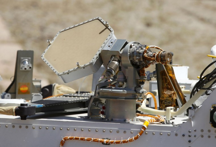 July 25, 2012: A high gain antenna is seen atop an engineering model of NASA's Curiosity Mars rover as it navigates a sandy, Mars-like environment named the Mars Yard at NASA's Jet Propulsion Laboratory in Pasadena, California. (Danny Moloshok/Reuters)