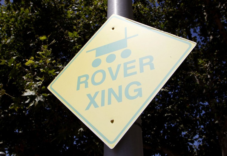 July 25, 2012: A Rover crossing sign is seen outside of a sandy, Mars-like environment named the Mars Yard where engineering models of NASA's Curiosity Mars rover are tested at NASA's Jet Propulsion Laboratory in Pasadena, California. (Danny Moloshok/Reuters)