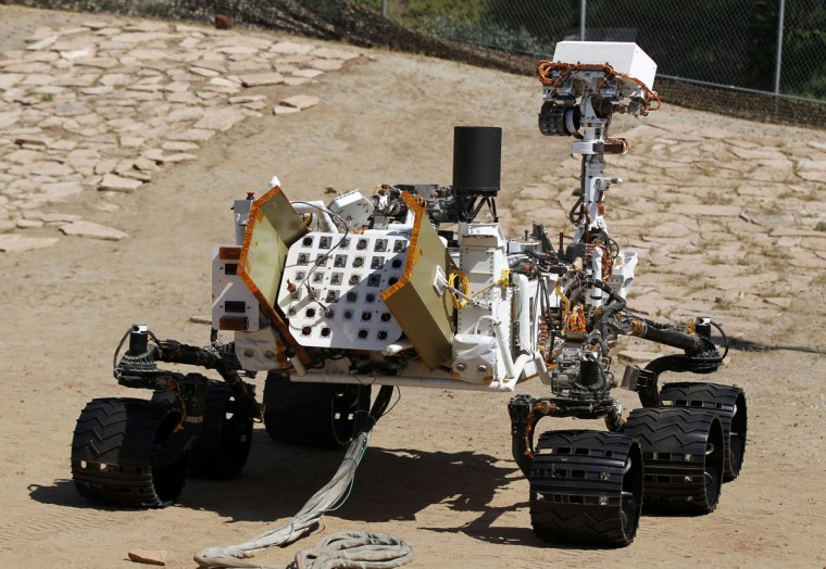 July 25, 2012: An engineering model of NASA's Curiosity Mars rover is seen from the rear in a sandy, Mars-like environment named the Mars Yard at NASA's Jet Propulsion Laboratory in Pasadena, California. (Danny Moloshok/Reuters)