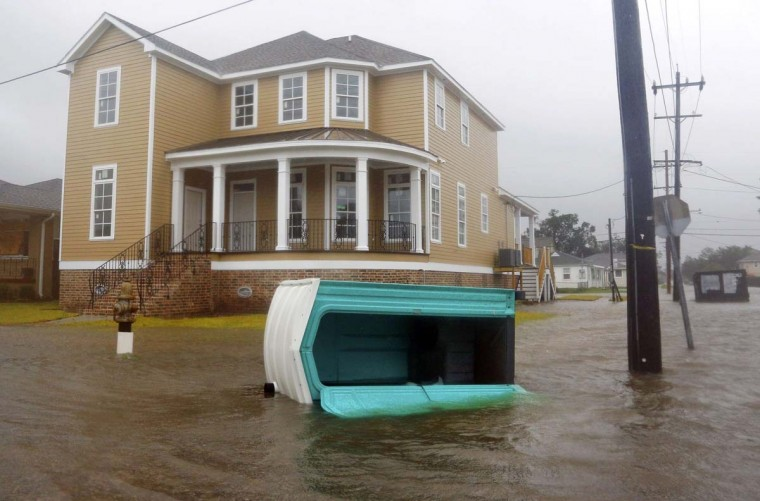 A porta-potty is seen floating on a flooded street as Hurricane Isaac passes through New Orleans, Louisiana. (Jonathan Bachman/Reuters photo)