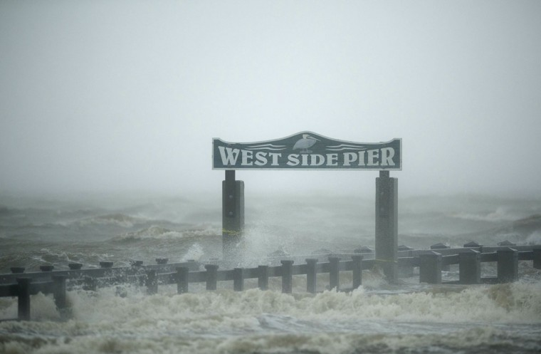 The surf washes over the West Side Pier as Hurricane Isaac passes through Gulfport, Mississippi, August 29, 2012. (Michael Spooneybarger/Reuters)