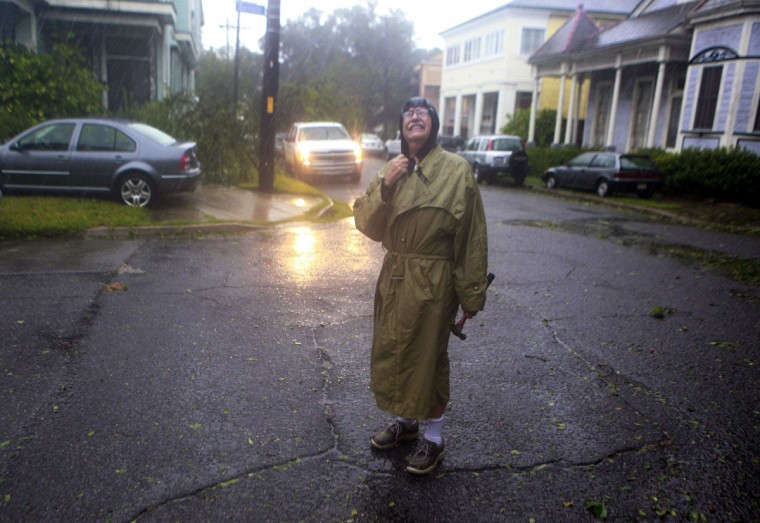 Henry Tabbe checks out the damage in his neighborhood near Esplande Ave. as Hurricane Isaac pushes into the New Orleans metro area in New Orleans, Louisiana, August 29, 2012. (Sean Gardner/Reuters)