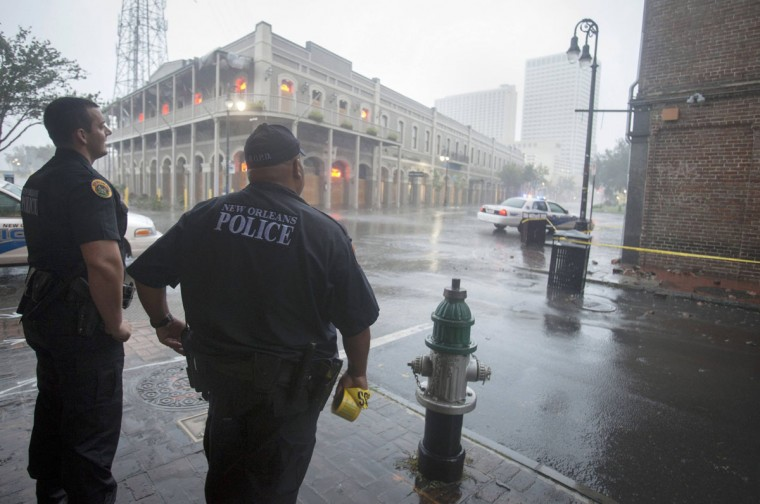 Police stand watch over a French Quarter intersection as Hurricane Isaac hits New Orleans, Louisiana August 29, 2012. (Lee Celano/Reuters)