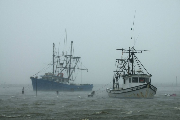 Boats are battered in the harbor as Hurricane Isaac passes through Pass Christian, Mississippi, August 29, 2012. The slow-moving but powerful Category 1 hurricane was felt along the Gulf Coast, threatening to flood towns in Mississippi and Louisiana with storm surges of up to 12 feet and top sustained winds up to 75 miles per hour. (Michael Spooneybarger/Reuters)