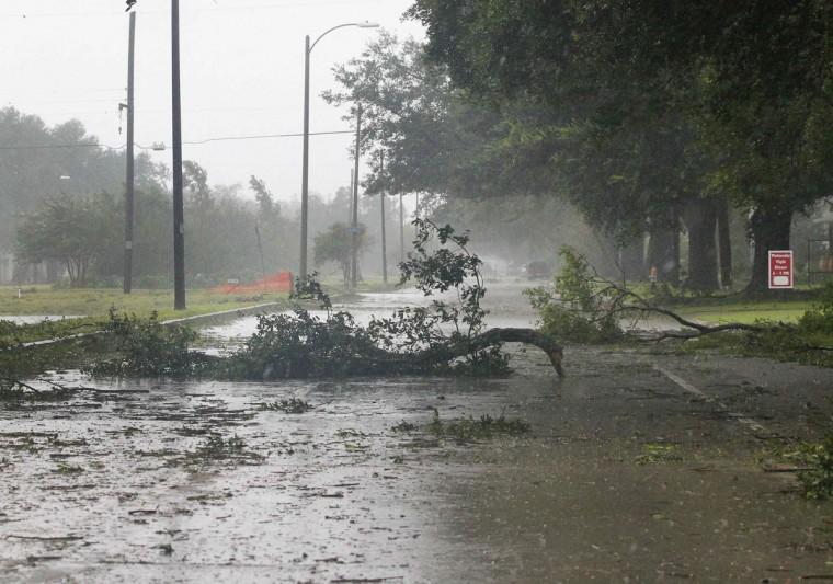 Debris lie on a road as Hurricane Isaac passes through New Orleans, Louisiana, August 29, 2012. (Jonathan Bachman/Reuters)