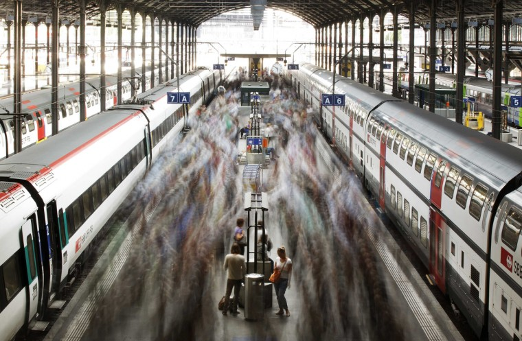 A long exposure picture shows commuters walking on a platform after leaving a train of the Swiss Federal Railways (SBB) at the main station in Lucerne. (Michael Buholzer/Reuters)