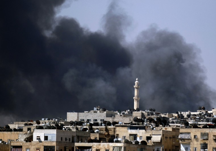 Smoke rises over the Salah al-Din neighbourhood in central Aleppo during clashes between Free Syrian Army fighters and Syrian Army soldiers August 4, 2012. (Goran Tomasevic/Reuters)