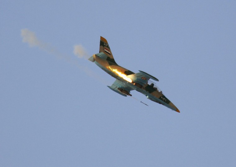 A Syrian Air Force fighter plane fires a rocket during an air strike in the village of Tel Rafat, some 37 km (23 miles) north of Aleppo, August 9, 2012. Syrian troops and rebels fought over the country's biggest city Aleppo as President Bashar al-Assad's key foreign backer Iran gathered ministers from like-minded states for talks on Thursday about how to end the conflict. (Goran Tomasevic/Reuters)