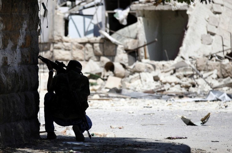 A Free Syrian Army fighter aims his sniper rifle Aleppo August 14, 2012. (Goran Tomasevic/Reuters)