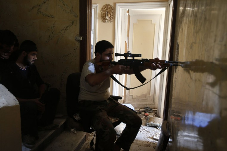 A Free Syrian Army sniper takes his position at the Seif El Dawla neighborhood in Aleppo August 27, 2012. (Youssef Boudlal/Reuters)