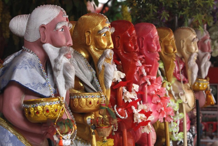 Statues of Chuchok, a greedy Brahmin who died in a story from the Buddhist Vessantara Jataka from gluttony due to his new found wealth, is seen at Baan Chuchok in Bangkok, Thailand. It is believed that wealth and luck would come to those who believe in Chuchok. (Chaiwat Subprasom/Reuters)