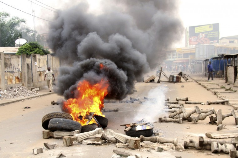 Opposition protesters burn tires as they block a street with barricades in Togo's capital Lome. Police in Togo fired tear gas and rubber bullets to try to disperse opposition protesters in the capital Lome on Wednesday, as tensions over upcoming legislative elections boiled over. (Noel Kokou Tadegnon/Reuters)