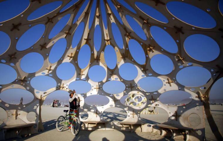 """Bingram Lai explores """"Zonotopia and the Two Trees"""" during the Burning Man 2012 """"Fertility 2.0"""" arts and music festival in the Black Rock Desert of Nevada. (Jim Urquhart/Reuters)"""