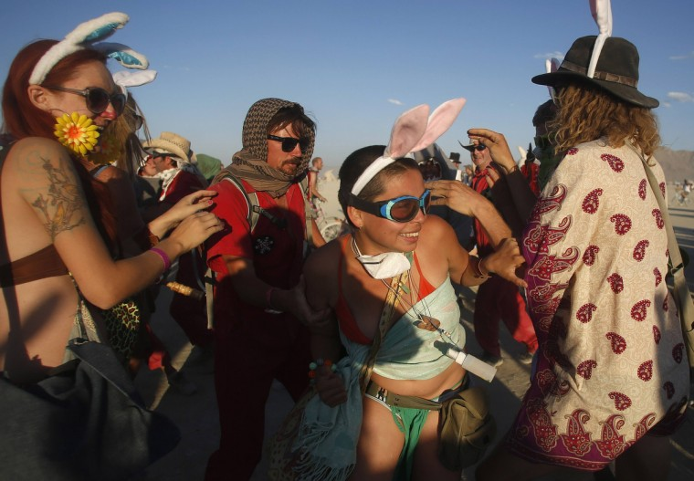 A woman wearing rabbit ears (C) tries to elude a member of Animal Control during the Billion Bunny March. (Jim Urquhart/Reuters)