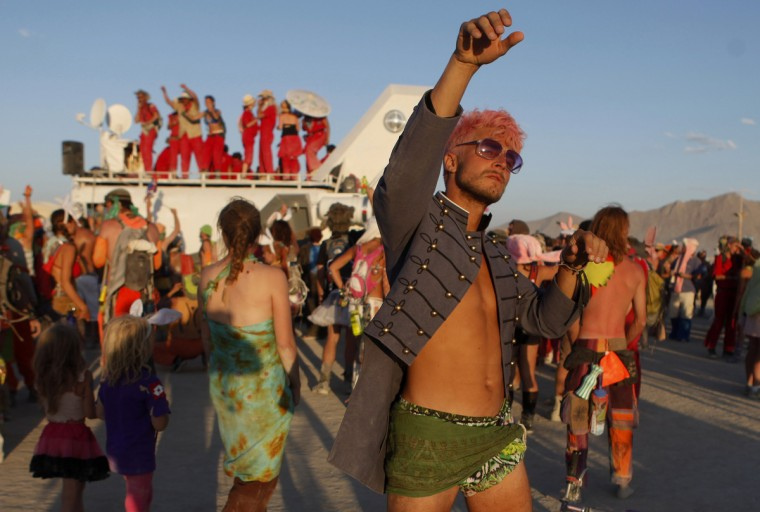 "Patrick Sperry dances during the Burning Man 2012 ""Fertility 2.0"" arts and music festival in the Black Rock Desert of Nevada. (Jim Urquhart/Reuters)"