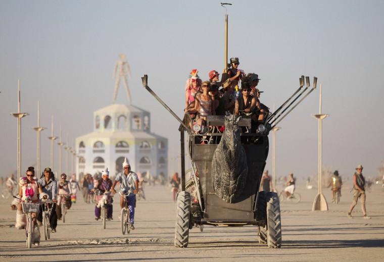 "Participants ride an art car during the Burning Man 2012 ""Fertility 2.0"" arts and music festival. (Jim Urquhart/Reuters)"