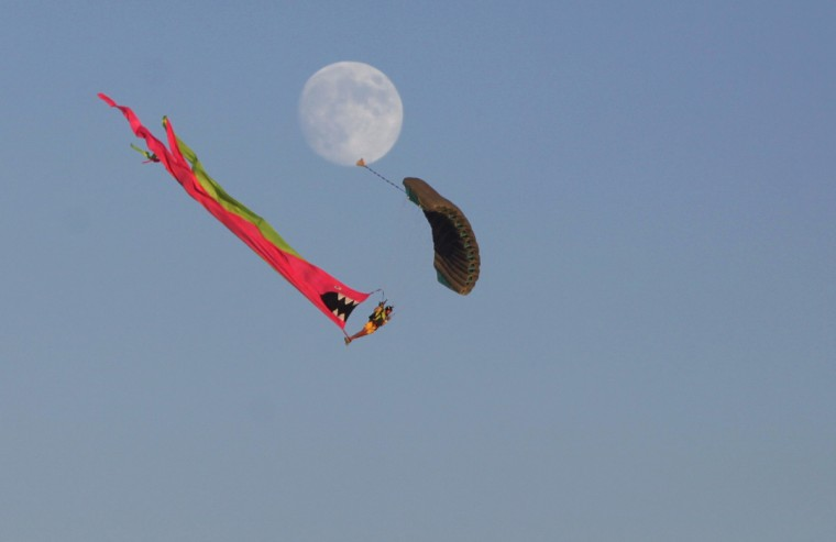 A skydiver descends to the Playa during the Burning Man festival. (Jim Urquhart/Reuters)