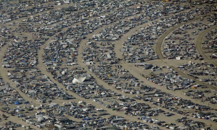 """An aerial view shows the Burning Man 2012 """"Fertility 2.0"""" arts and music festival in the Black Rock Desert of Nevada. (Jim Urquhart/Reuters)"""