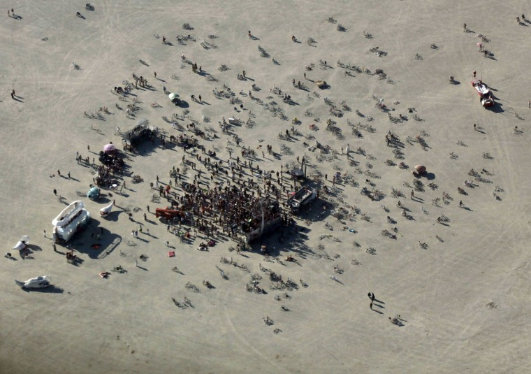 "An aerial view shows a dance party during the Burning Man 2012 ""Fertility 2.0"" arts and music festival in the Black Rock Desert of Nevada. (Jim Urquhart/Reuters)"