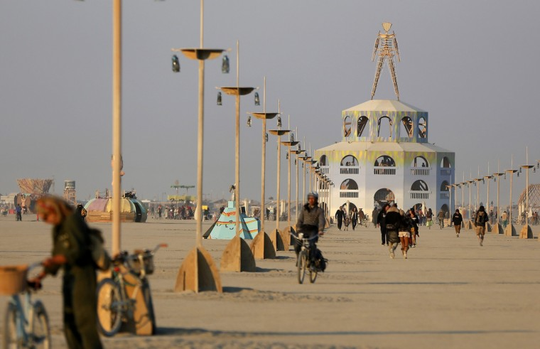 """The Man is seen at sunrise during the Burning Man 2012 """"Fertility 2.0"""" arts and music festival. (Jim Urquhart/Reuters)"""