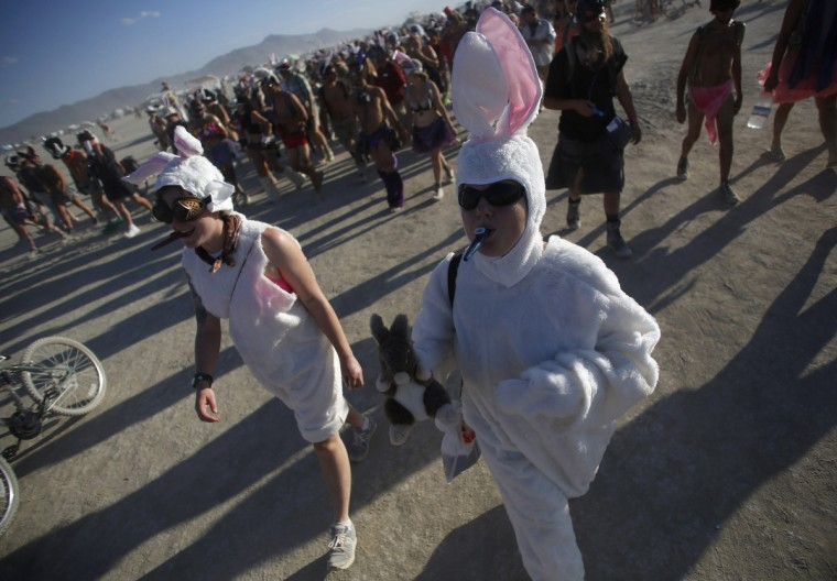 """Participants dressed as rabbits participate in the Billion Bunny March during the Burning Man 2012 """"Fertility 2.0"""" arts and music festival. (Jim Urquhart/Reuters)"""