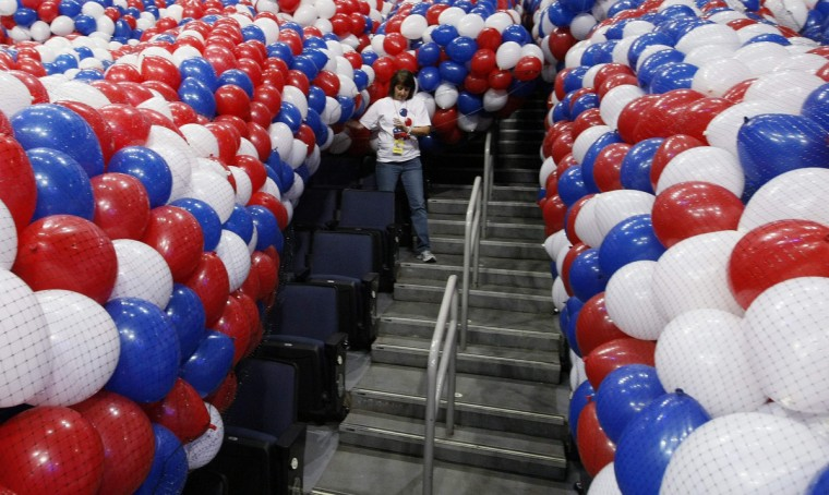 A woman carries balloons to be dropped from the ceiling at the Republican National Convention in Tampa, Florida. The convention starts Monday August 27. (Rick Wilking/Reuters)