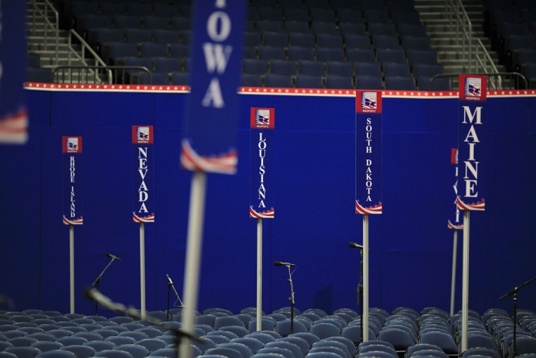 Signs are seen at the Republican National Convention in Tampa, Florida August 27, 2012. Tropical Storm Isaac forced Republicans on Sunday to rewrite the script for their national convention in Tampa as party officials scrambled to make sure candidate Mitt Romney's message to voters would not be blown off course. (Eric Thayer/Reuters)