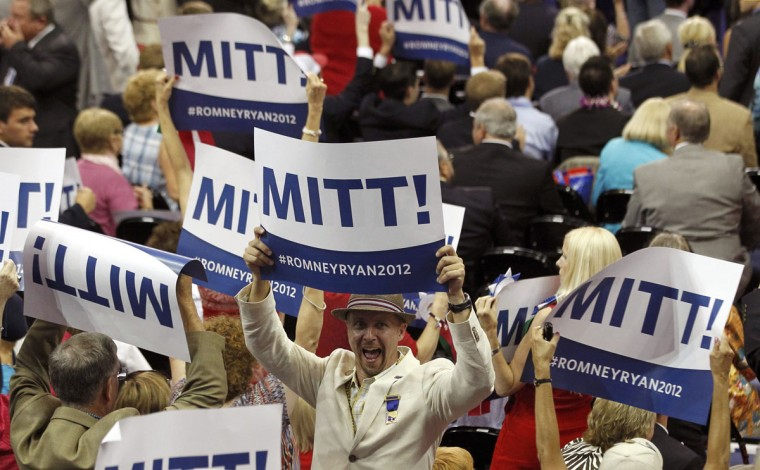Delegates celebrate with MITT! signs after Republican presidential nominee Mitt Romney got the necessary delegate votes to put him over the top and secure the Republican presidential nomination, during the second day of the Republican National Convention in Tampa, Florida. (Jason Reed/Reuters))