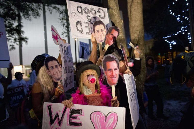 Code Pink protesters hold masks of Republican presidential nominee Mitt Romney and vice presidential running mate Paul Ryan as they take part in demonstration outside the Republican National Convention in Tampa, Florida. (Philip Andrews/Reuters)