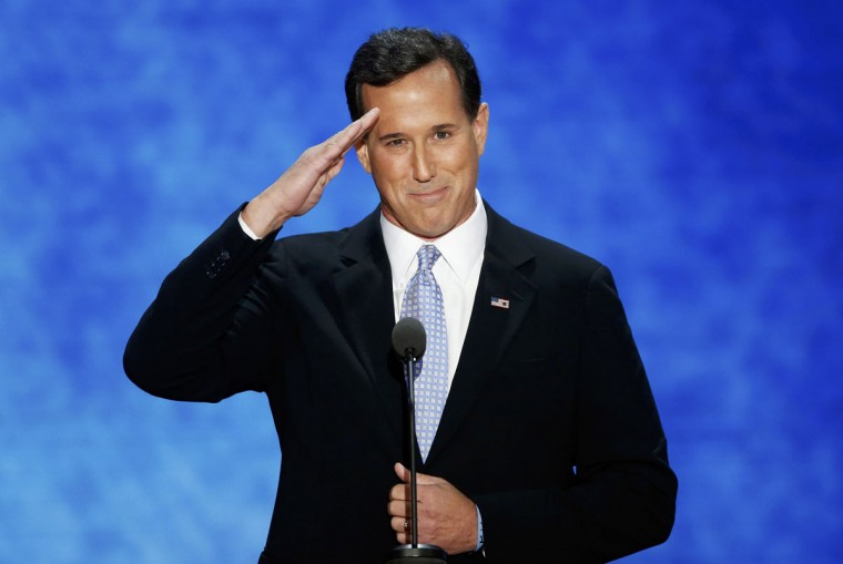 Former U.S. Republican presidential candidate Rick Santorum salutes as he arrives to address delegates during the second session of the Republican National Convention in Tampa, Florida, August 28, 2012. (Mike Segar/Reuters)