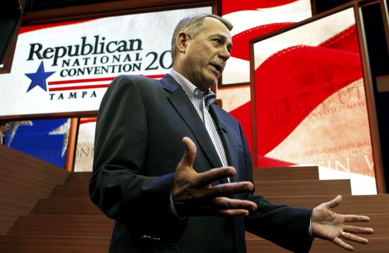 House Majority Leader John Boehner, permanent chairman of the Republican National Convention, talks with the MEDIA before gaveling in the opening session in Tampa, Florida August 27, 2012. (Jim Bourg/Reuters)