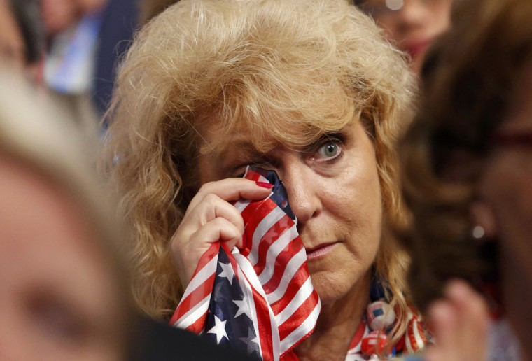 Cheryl Howell, a delegate from North Branch, Michigan, wipes tears from her eyes during the final session of the Republican National Convention in Tampa, Florida. (Adrees Latif/Reuters)