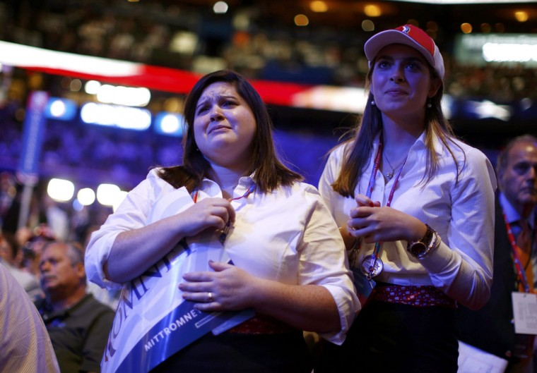 Pages react to a video show presented about the the two Bush Presidents during the third day of the Republican National Convention in Tampa, Florida, August 29, 2012. (Jason Reed/Reuters)