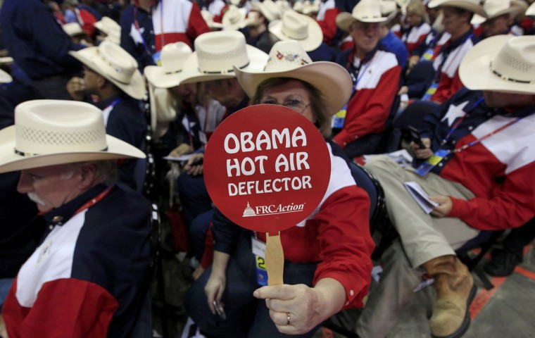 A delegate from Texas holds up a sign referring to President Barack Obama during the second session of the Republican National Convention in Tampa, Florida. (Shannon Stapleton/Reuters)