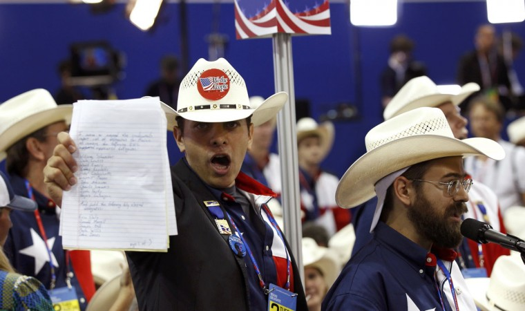 Delegates shout in protest over changes in Republican party rules that would restrict the impact of grassroots movements, before a vote to adopt the new rules during the second session of the Republican National Convention in Tampa, Florida. (Shannon Stapleton/Reuters)
