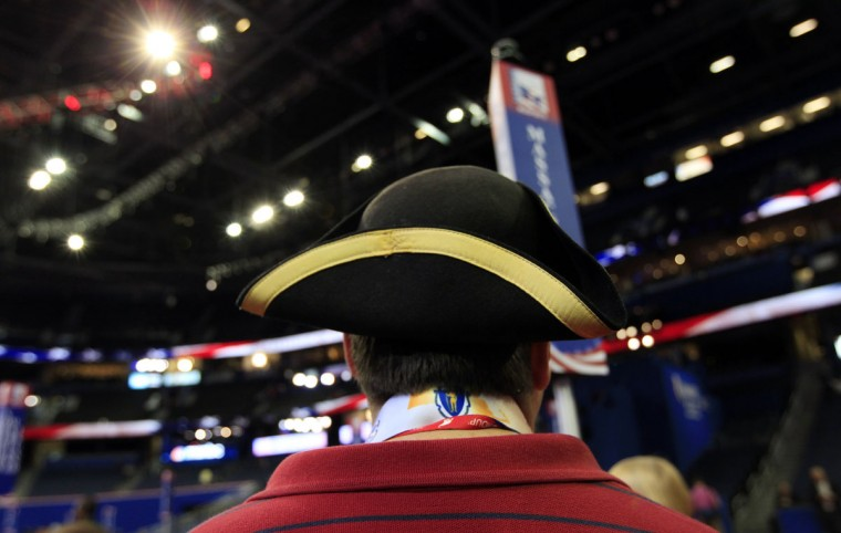 Convention guest Tom Moor of Dedham, Massachusetts, wears a colonial tri-corner hat as he walks the floor of the Republican National Convention before the start of the first session of the convention in Tampa, Florida August 27, 2012. (Shannon Stapleton/Reuters)