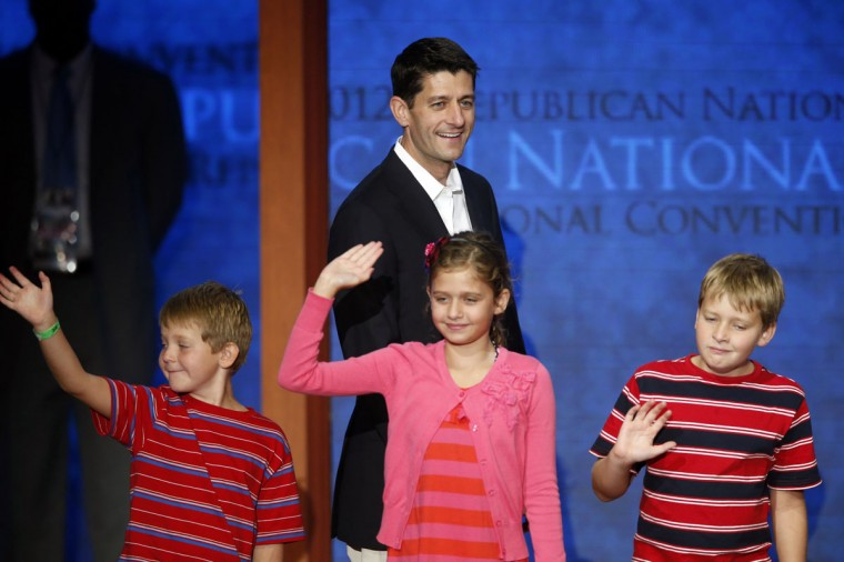 U.S. Congressman and Republican vice presidential candidate Paul Ryan (R-W) visits the stage ahead of his address to the Republican National Convention in Tampa, Florida, August 29, 2012. With Ryan are his children Liza (C) Charlie (L) and Sam. (Mike Segar/Reuters)