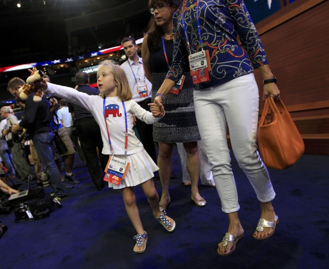 A young delegate arrives before the start of opening session of the Republican National Convention in Tampa, Florida, August 27, 2012. (Mike Segar/Reuters)