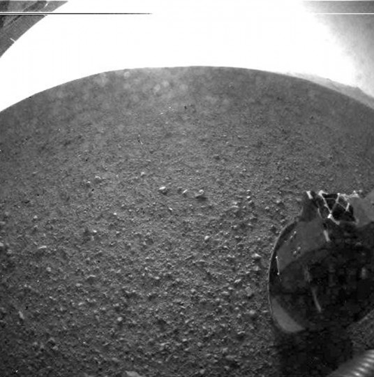 August 6, 2012: About two hours after landing on Mars and beaming back its first image, NASA'­s Curiosity rover transmitted a higher-resolution image of its new Martian home, Gale Crater. Mission Control at NASA's Jet Propulsion Laboratory in Pasadena, California, received the image, taken by one of the vehicle's lower-fidelity, black-and-white Hazard Avoidance Cameras or Hazcams. (Courtesy NASA/Handout/Reuters)