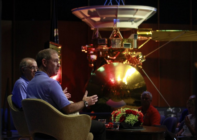 August 5, 2012: Dr. Charles Elachi, JPL Director, NASA Jet Propulsion Lab (L), and John Grunsfeld, NASA associate administrator, NASA headquarters, speak during a news conference at NASA's Jet Propulsion Lab in Pasadena, California. A scale model of the Cassini spacecraft which is still orbiting Saturn is shown in the background. (Fred Prouser/Reuters)