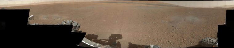 (Click to ZOOM in. Then double-click to ZOOM and MOVE around the image.) August 9, 2012: The first 360-degree panorama in color of the Gale Crater landing site in Mars taken by NASA's Curiosity rover. The panorama was made from thumbnail versions of images taken by the Mast Camera on August 8. Scientists will be taking a closer look at several splotches in the foreground that appear gray. These areas show the effects of the descent stage's rocket engines blasting the ground. What appeared as a dark strip of dunes in previous, black-and-white pictures from Curiosity can also be seen along the top of this mosaic, but the color images also reveal additional shades of reddish brown around the dunes, likely indicating different textures or materials. (NASA/JPL-Caltech/MSSS/Handout/Reuters)