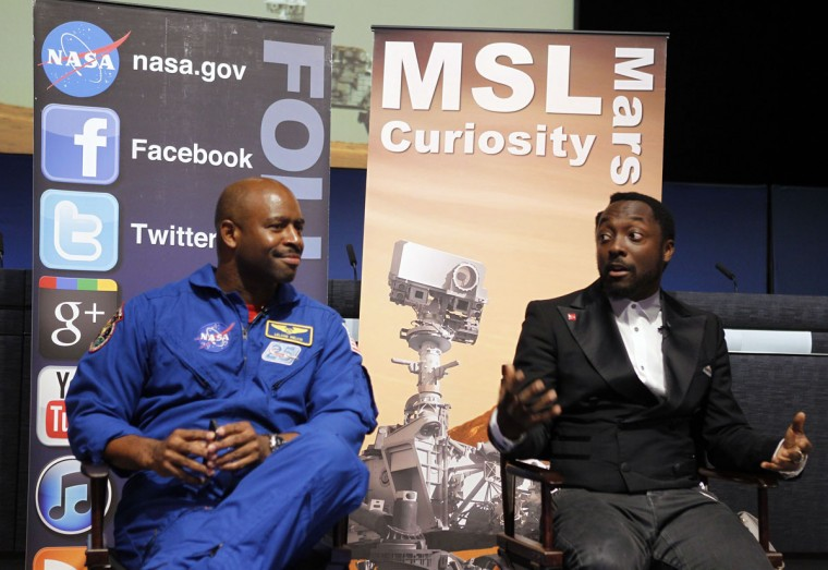 August 5, 2012: Musician will.i.am (R) and NASA astronaut Leland Melvin speak during a news conference at NASA's Jet Propulsion Lab in Pasadena, California. will.i.am attended the conference to promote science and technology education. (Fred Prouser/Reuters)